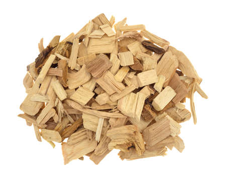 flavoring: Top view of a small pile of hickory wood smoking chips for flavoring barbecue and grilled foods isolated on a white background.