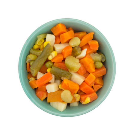 mixed vegetables: Top view of a portion of mixed vegetables in a small bowl isolated on a white background.