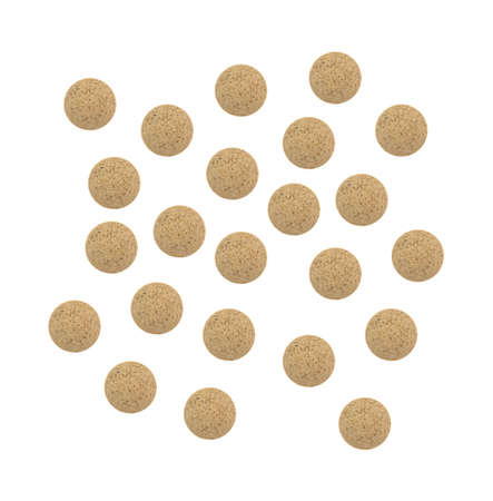 brewers: Top view of several brewers yeast nutritional supplement tablets isolated on a white background. Stock Photo