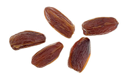 Top view of a group of Tunisian pitted dates isolated on a white background.