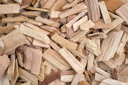 Close view of hickory wood smoking chips for flavoring barbecue and grilled foods.