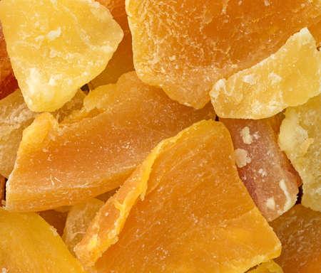 A very close view of pineapple, mango and papaya sugared dried fruit.