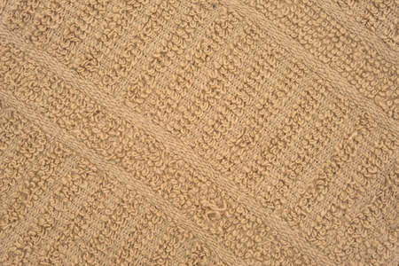 dishcloth: A very close view of a beige kitchen dish cloth. Stock Photo