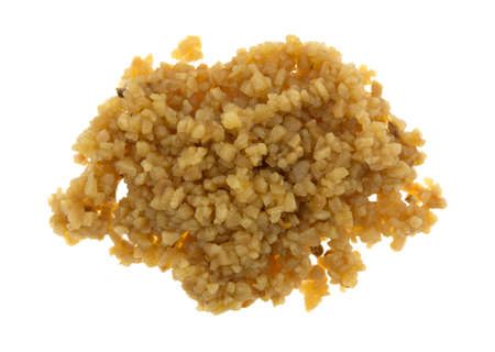 Top view of a portion of roasted minced garlic isolated on a white background. Фото со стока