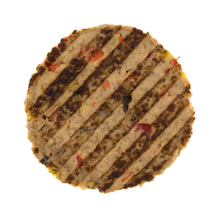 Top view of a veggie burger patty isolated on a white background.