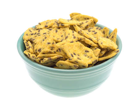 organic flax seed: Side view of a filled bowl of flax seed corn chips isolated on a white background.