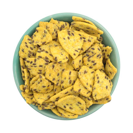 organic flax seed: Top view of a filled bowl of flax seed corn chips isolated on a white background.