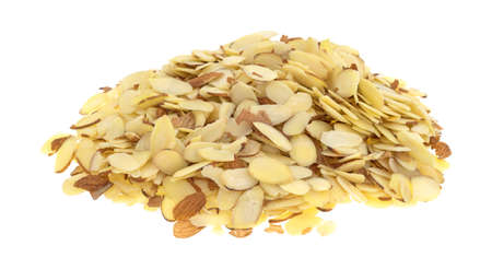 A large portion of sliced almonds isolated on a white background. Фото со стока