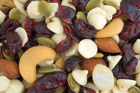 A very close view of an assortment of nuts and dried cranberries trail mix. 版權商用圖片
