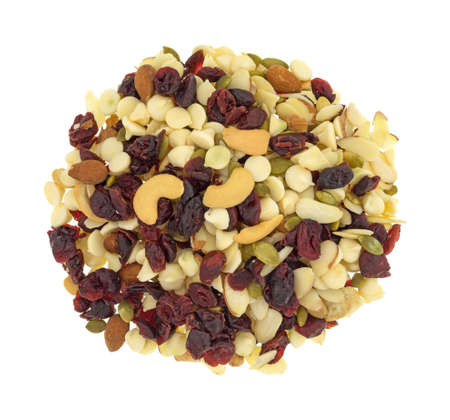 Top view of a portion of an assortment of nuts and dried cranberries trail mix isolated on a white background.