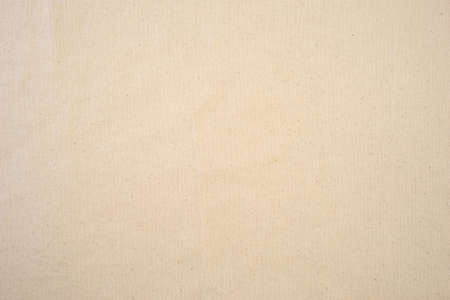 beige: Top view of a beige speckled tablecloth.