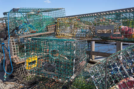 jumble: Several lobster traps stacked in an jumble on a working dock in the late spring at Belfast, Maine. Stock Photo