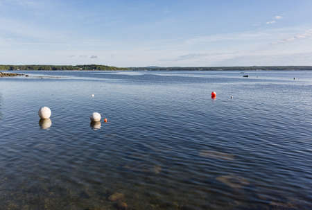buoys: Wide view of the buoys in the harbor at Northport Maine in the early morning light. Stock Photo