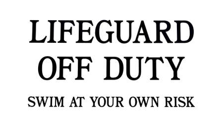 Close view of a lifeguard off duty warning sign.