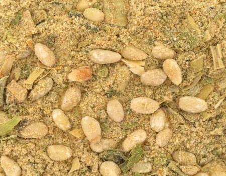 pinoli: A very close view of pine nuts and seasonings.