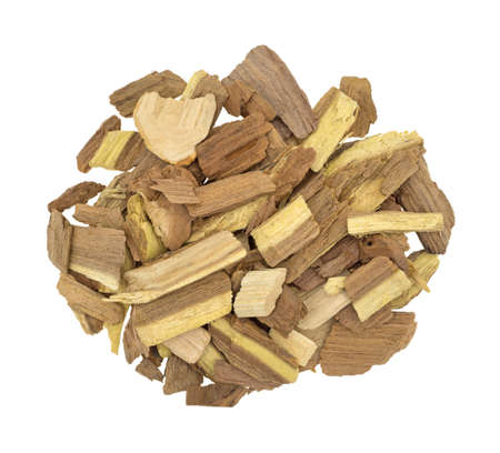 flavoring: Top view of a small pile of mesquite wood smoking chips for flavoring barbecue and grilled foods isolated on a white background. Stock Photo