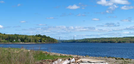 A distant view of the Penobscot Narrows Bridge from Sandy Beach in Stockton Springs, Maine. Stock Photo