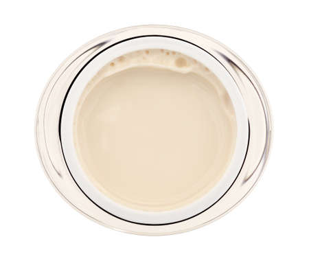 Top view of an opened jar of moisturizing face cream isolated on a white background.