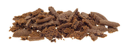 crumbled: Several Dutch cocoa cookies crumbled into pieces isolated on a white background.