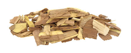 flavoring: A small pile of mesquite wood smoking chips for flavoring barbecue and grilled foods isolated on a white background.