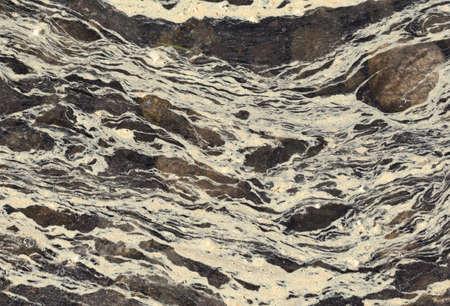alergenos: Las hebras de polen y escoria de alto de agua salada con piedras en la parte inferior. Foto de archivo