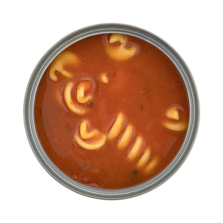 rotini: An opened can of rotini tomato soup isolated on a white background top view. Stock Photo