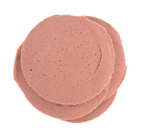 bologna baloney: Several slices of chicken bologna in a stack on a white background top view.