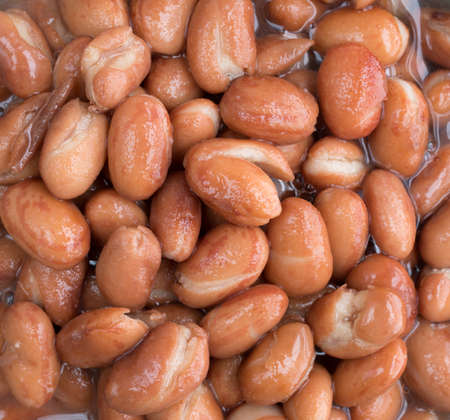 shelled: Very close view of shelled beans in liquid.