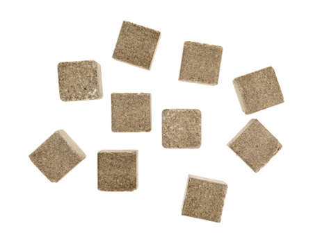 Top view of a group of beef flavored bouillon cubes isolated on a white background.