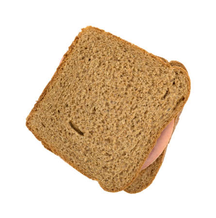 Top view of a mortadella sandwich on whole wheat bread isolated on a white background. Stock Photo