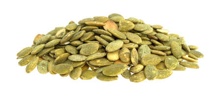 A portion of organic dry roasted pumpkin seeds isolated on a white background. Stockfoto