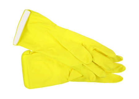 A pair of yellow plastic housework gloves isolated on a white background.