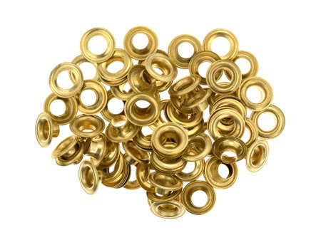 rustproof: Several brass grommets isolated on a white background.