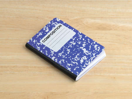 composition notebook: A blue composition notebook on a wood table. Stock Photo