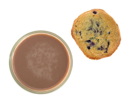 blueberry muffin: Top view of a glass of chocolate milk with a blueberry muffin isolated on a white background.