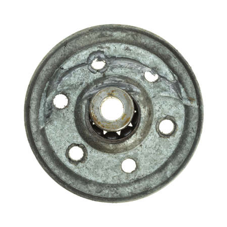 gouged: A broken garage door pulley with the ball bearings blown out on a white background.