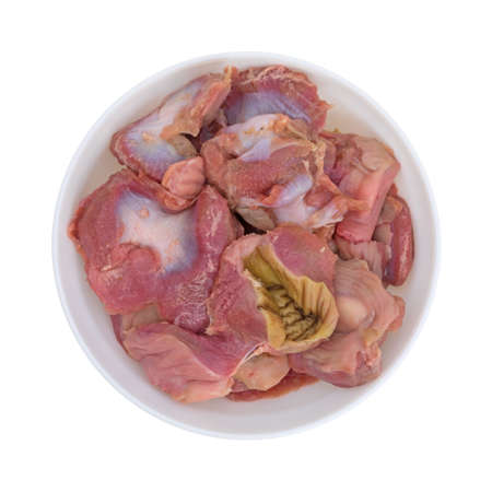 A bowl filled with fresh chicken gizzards and hearts on a white background.