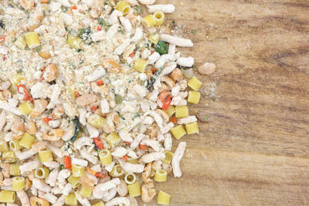white bean: Dry white bean dry soup mix on an old wood cutting board. Stock Photo
