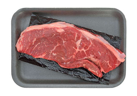 short cut: Top view of an all natural short cut rump steak on a black foam butchers tray atop a white background.
