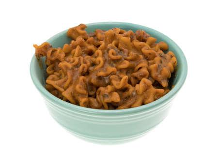 marinara sauce: A bowl of cooked marinara pasta isolated on a white background. Stock Photo