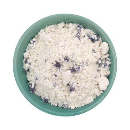 blueberry muffin: Top view of imitation blueberry muffin mix in a green bowl isolated on a white background.
