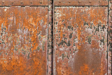rivets: A rusty metal surface with structural joints and rivets.