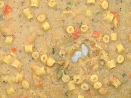 leftovers: A very close view of leftover soup in the bottom of a pan.