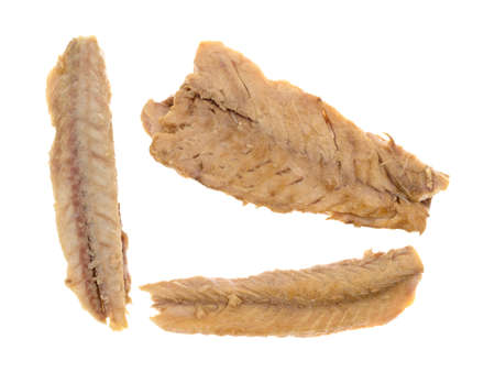 Top view of skinless mackerel fillets on a white background.