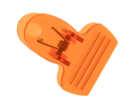 metal fastener: Top view of an orange plastic clip isolated on a white background. Stock Photo