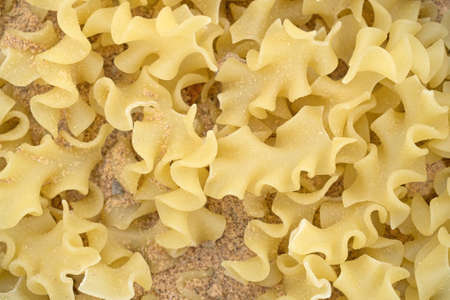 Top close view of pasta with dry seasonings.