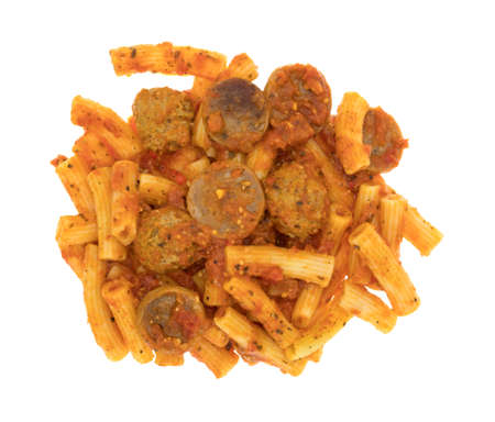 marinara sauce: Top view of a portion of rigatoni pasta with sausage and meatballs in a marinara sauce isolated on a white background.