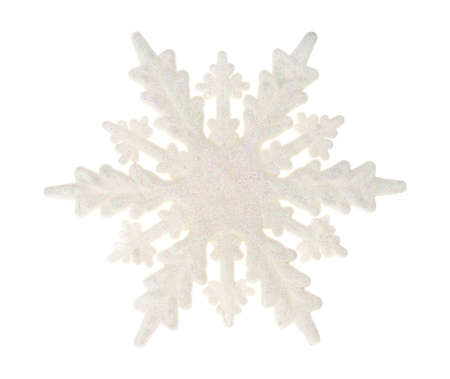 A large plastic snowflake with glitter isolated on a white background. Stock Photo