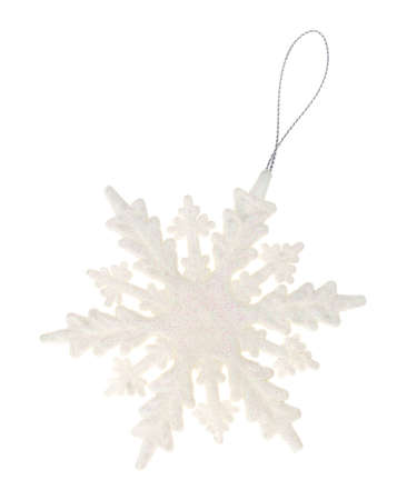 A large plastic snowflake ornament with glitter isolated on a white background.