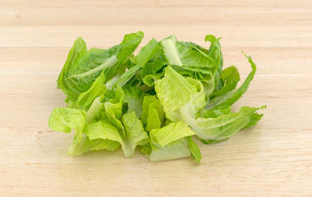 romaine lettuce: Romaine lettuce that has been sliced on a wood cutting board. Stock Photo